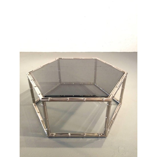 A faux bamboo hexagon coffee or cocktail table made by Mastercraft. Consist of a nickel base that is made to resemble...