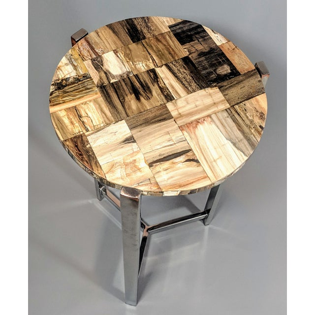 This authentic petrified wood side table would look great in any room. Colors range includes ebony, smokey, chocolate, and...