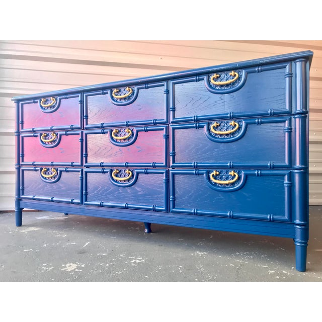 Amazing vintage Hollywood Regency, faux bamboo nine-drawer dresser newly lacquered in a navy blue with lovely lacquered...