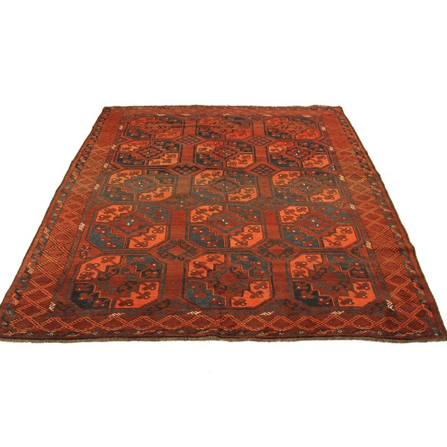 Afghan area rug handwoven from the finest sheep's wool. It's colored with all-natural vegetable dyes that are safe for...
