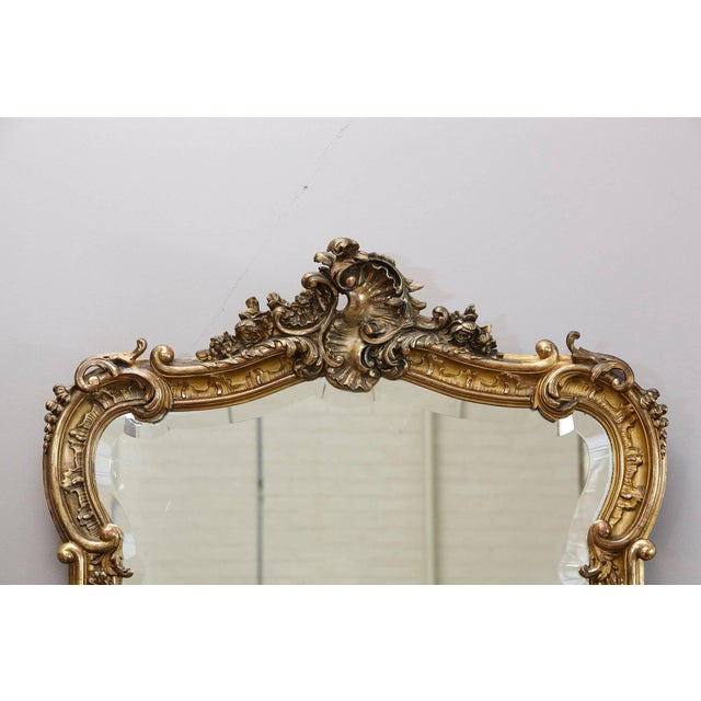 Beautiful 19th century French Rococo mirror with an moulded frame with finely carved foliate scrolling and rosettes,...