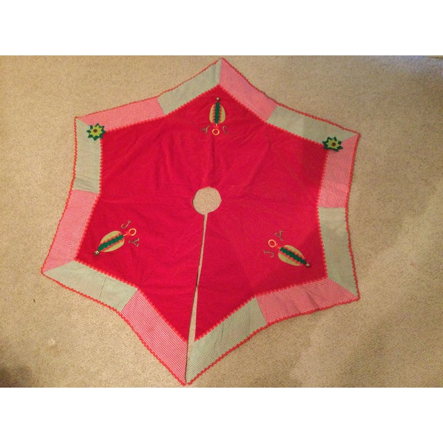 Vintage red velvet tree skirt. Large 52 inches. Trimmed in red and green gingham checks for an old fashioned look. The...
