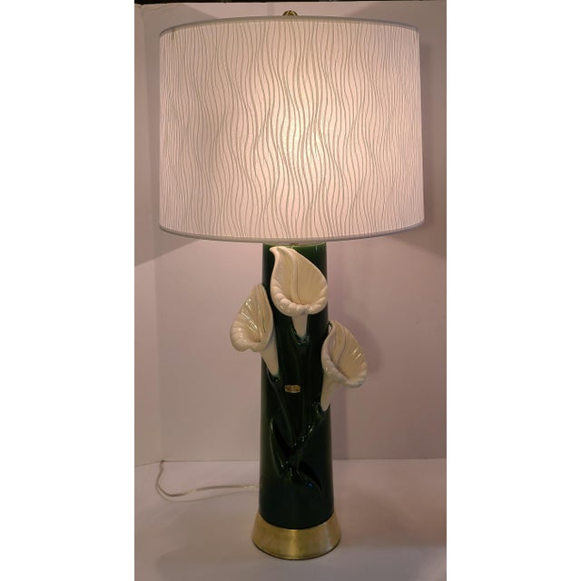 Signed Mid-Century Haeger Peace Lily Lamp in a dark green ceramic on brass. This stunning lamp has all new electrical with...