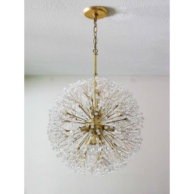 Circa 1960s Italian nine light Starburst chandelier ceiling light in the manner of Emil Stejnar. These lights are also...