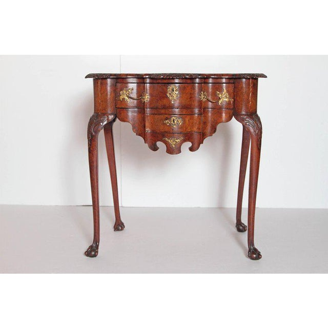 18th century Dutch burl wood lowboy with serpentine outline having 2 drawers, with original Rococo style brassware and...