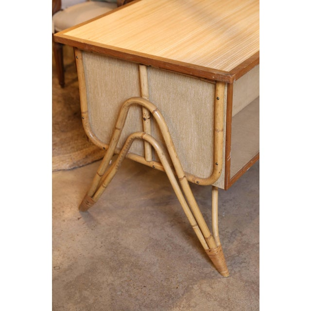 A small and charming three-drawer bamboo desk and chair from France. The desk is constructed of wood and fiber board with...
