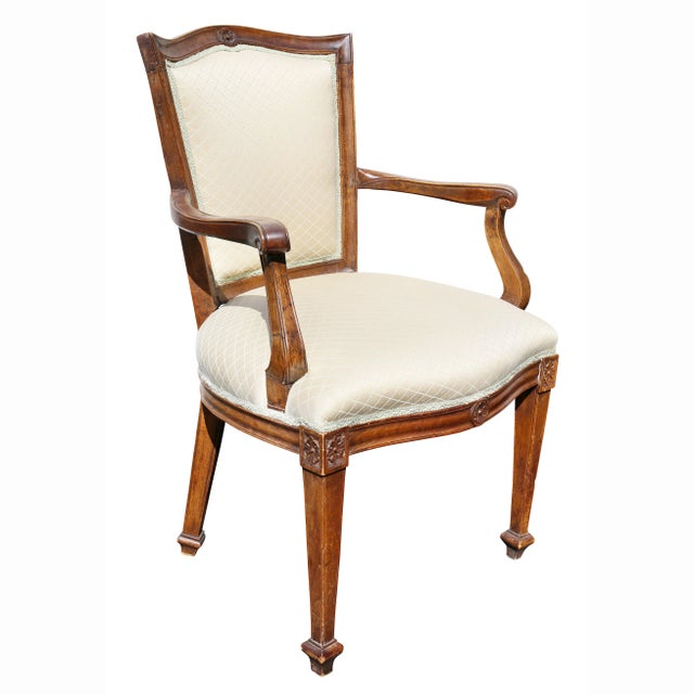 Each with serpentine crest rail with central circular carving over an upholstered back and feat, raised on square tapered...