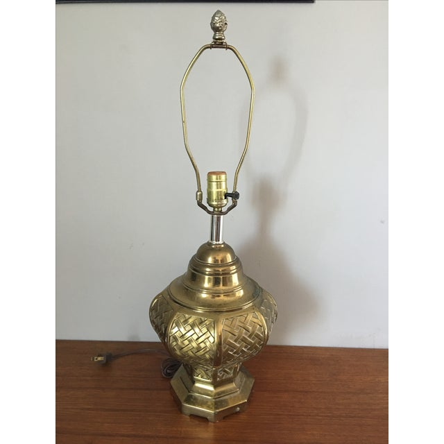 Vintage brass table lamp in a basketweave pattern. Heavy, quality construction. No maker's mark. Some spots of wear...