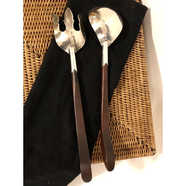 Vintage serving set made of sterling silver and walnut. Has been well preserved with some minor scratches noted to silver....