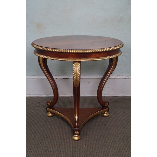 Store Item #: 14581 Flame Mahogany Round Partial Gilt Regency Style Center Table AGE/COUNTRY OF ORIGIN: Approx 20 years,...