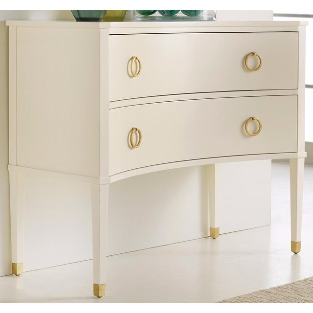 Offered is a two drawer concave side chest with a non distressed clean white finish. Has antique brass hardware and...