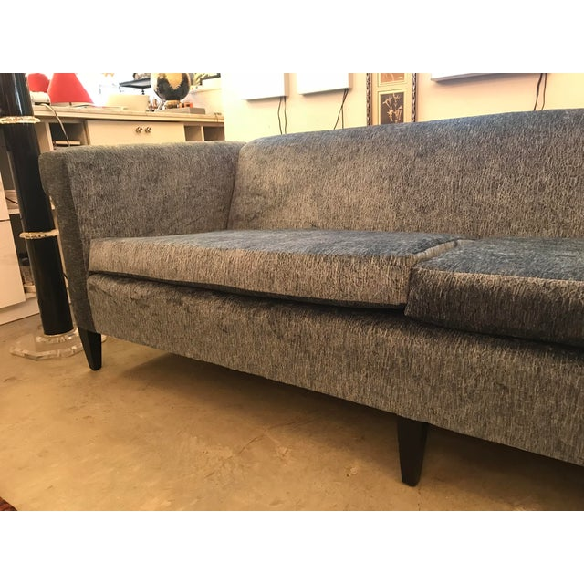 This a beautifully restored 1940's, 2 cushion sofa. It has squared wrap-around arms, that roll out on each side. The sofa...