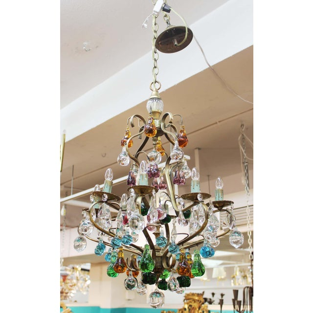 Charming Italian Mid Century Modern Murano glass fruit chandelier with brass frame and original glass pendants and colored...