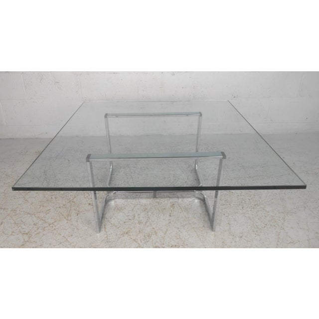 This unique midcentury coffee table makes a sturdy and stylish centre table for any seating area. The heavy flat bar...