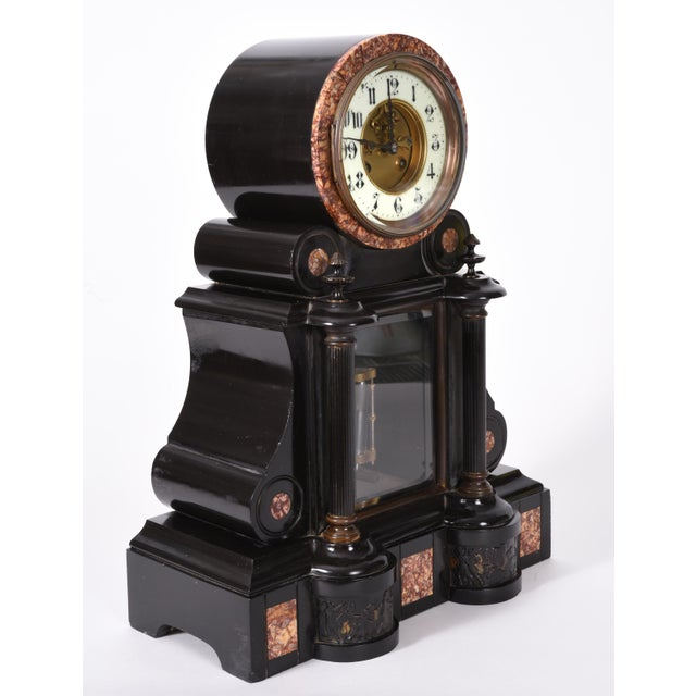 Beautiful antique French marble and bronze mantle clock . This clock is in excellent working antique condition. The mantle...