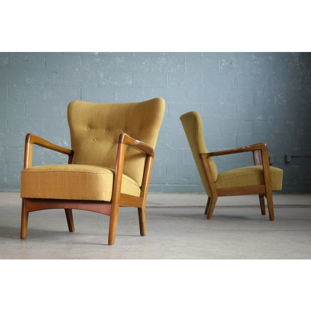Very stylish open armchairs designed by Soren Hansen for Fritz Hansen in the early 1940s. Mainly made with high backs this...
