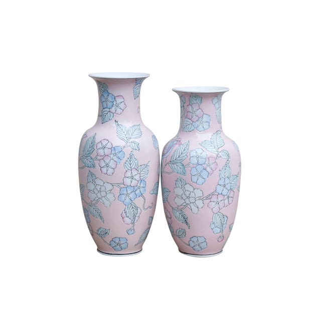 A pair of matching ceramic vases in blush. Embossed and decorated throughout with roses and Asian Paradise Fly Catchers in...