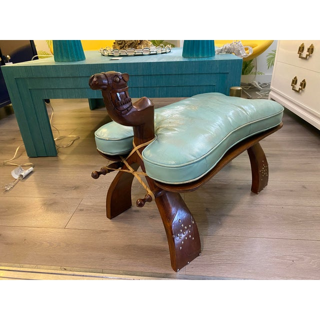 Gorgeous camel stool with blue leather cushion.