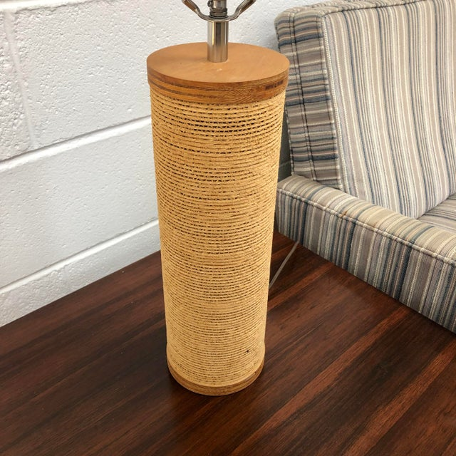 Mid century corrugated cardboard and wood lamp designed by Gregory Van Pelt. In working condition with original wiring....