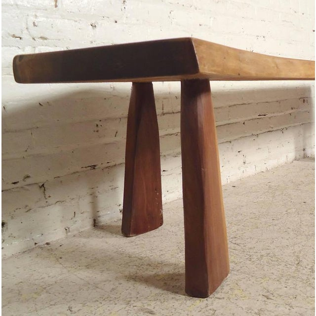 Large slab bench professionally refinished. Sturdy legs with exposed notches, unique live edge shape, strong walnut wood....
