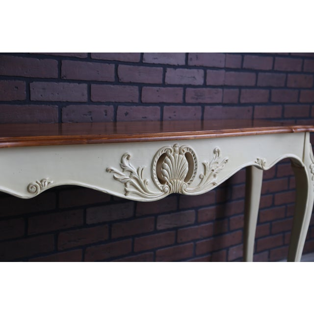 French Provincial sofa table with planked design veneer top. Finely crafted of maple featuring the Brittany with Russet...