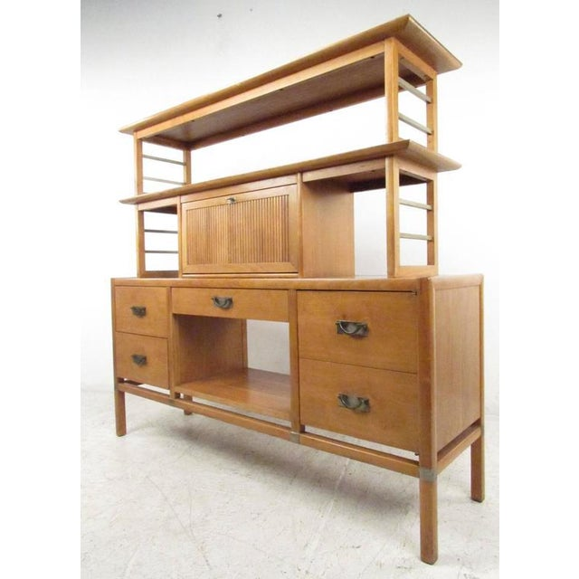 Unique desk or bookcase wall unit with drop down writing surface, multiple storage drawers, with open shelf space, circa...