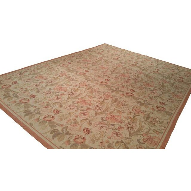 Infuse a touch of elegance to high-traffic areas of your home with this durable needlepoint rug in colors of peach, green,...