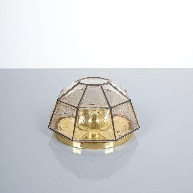 Glashütte Limburg brass and glass flush mount ceiling lamp, Germany, 1960. Beautiful clear glass light, polygonal shaped...