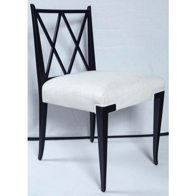 Immaculately restored and in excellent condition. Hard to find double 'X' back chairs by Tommi Parzinger in beautiful,...
