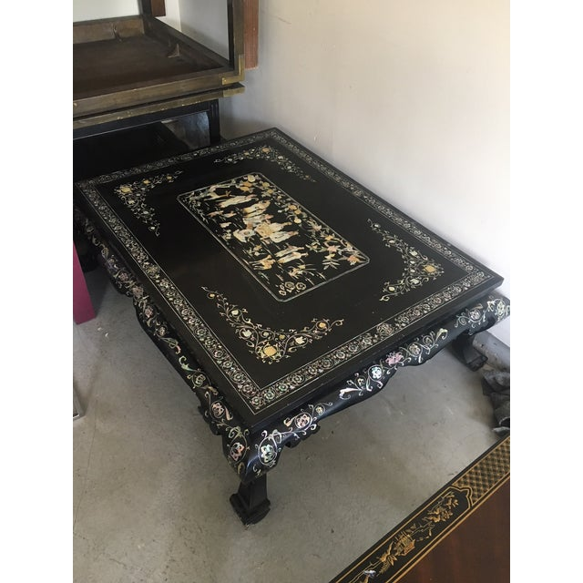 Oriental lacquer coffee table with mother-of-pearl inlay. The scene of noblemen playing a game of checkers.