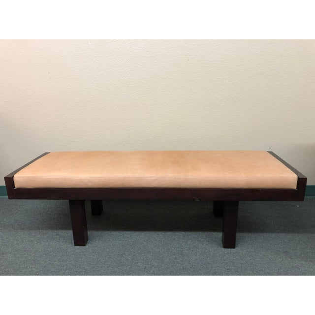 Design Plus Gallery presents a custom Coach leather bench. Minor visible wear on leather top. A dark espresso finish...