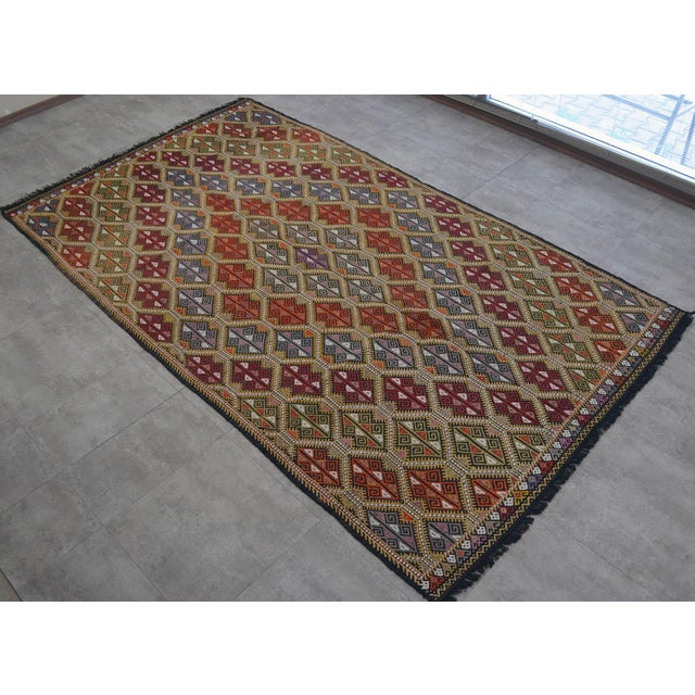 A Vintage Turkish Kilim handwoven wool Jajim rug made of hand spun wool on goat hair and natural dyes. The condition is...