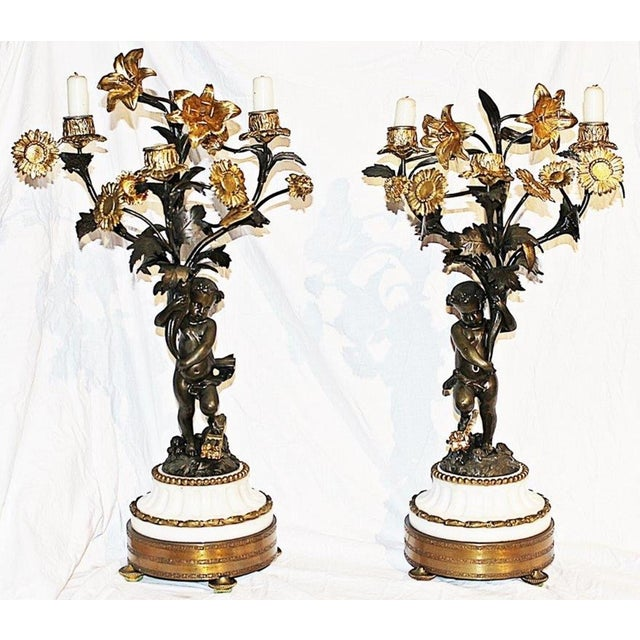 Elegance returns with this pair of antique French dore'-bronze candleabra with three candle holders. Finished in 23k gold...