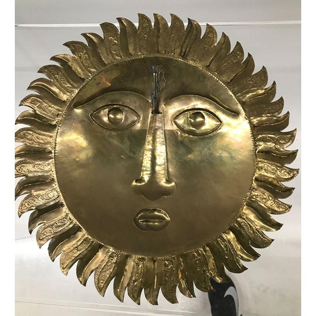 Striking brass and copper handmade sun wall decor, c.1970s. Possibly by Mexican artist and sculptor Sergio Bustamante or...