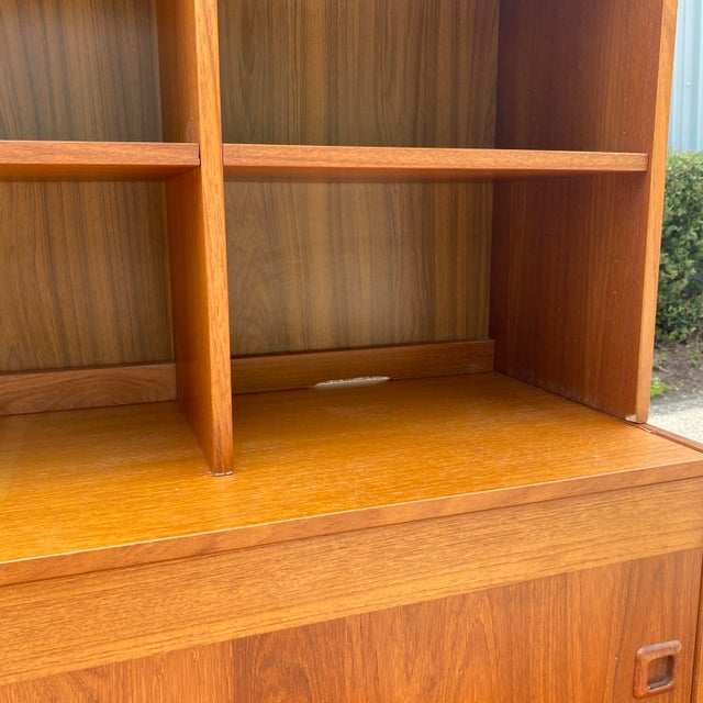 Here we have a good looking Danish Modern low Credenza/ storage with a modular bookshelf that has adjustable shelving. The...