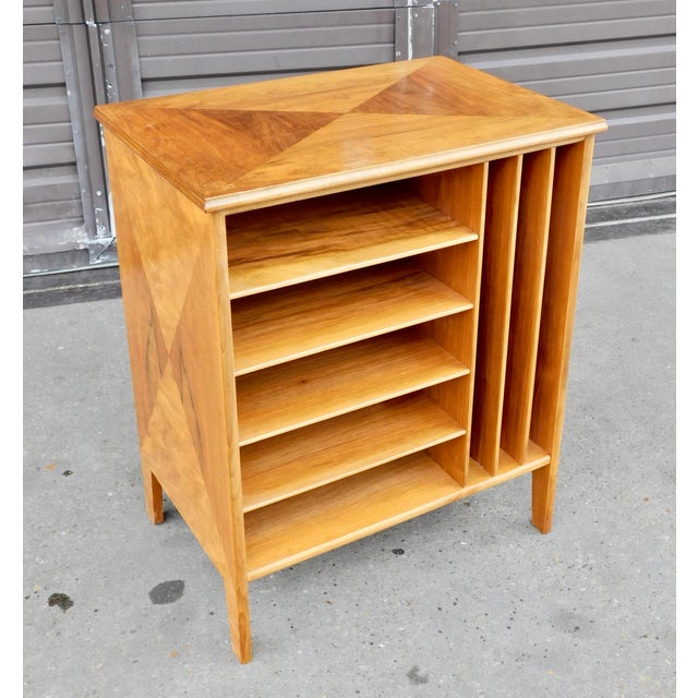 Swedish mid-century modern open shelved filing cabinet rendered in parquetry inlaid walnut. In great original condition...