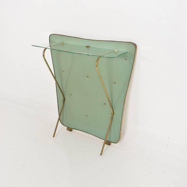 For your consideration a Mid-Century Modern wall console. Made in Italy circa the late 1950s. Wood board with original...