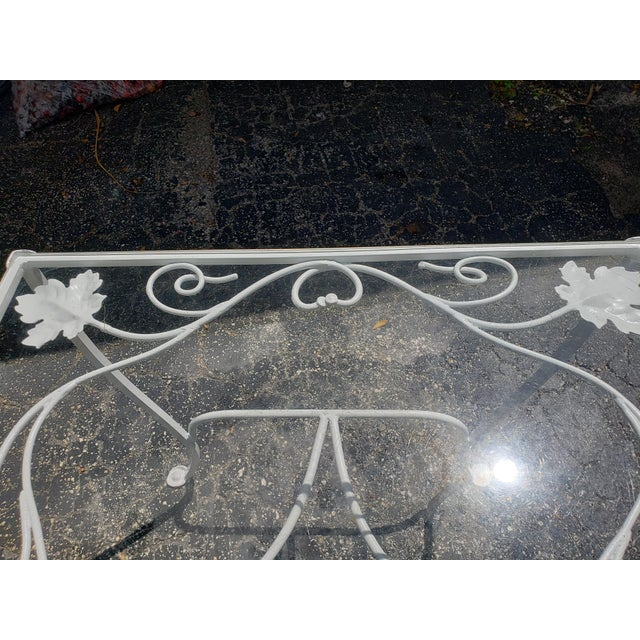 This is a beautiful wrought iron Salterini Maple Leaf pattern demilune console table. Imagine this in your entry or...