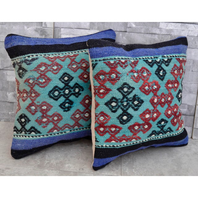 Offered are a beautiful pair of bohemian pillows in new condition made from old Turkish rugs. Made with a Turkish Kilim...
