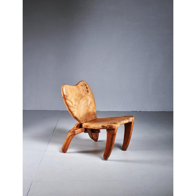 A highly sculptural studio crafted solid maple chair by American-Mexican woodworker Don Shoemaker. Labeled as made in...