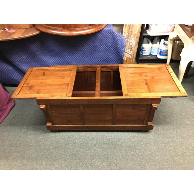 Design Plus Consignment Gallery presents a vintage Asian bamboo inset coffee table or storage trunk. The two sliding...