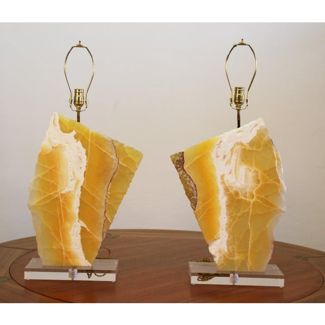 Vintage pair of marble stone table lamps in good working condition. The marble and lucite base are in excellent condition....