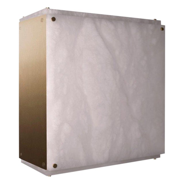 This contemporary light made of alabaster is part of the Orphan Work brand and can be used as a wall sconce or ceiling...