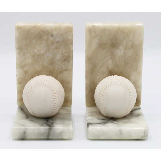 A superb Vintage pair of Italian White Alabaster Baseball Bookends. These are hand-carved, made in Italy, circa 1950. This...