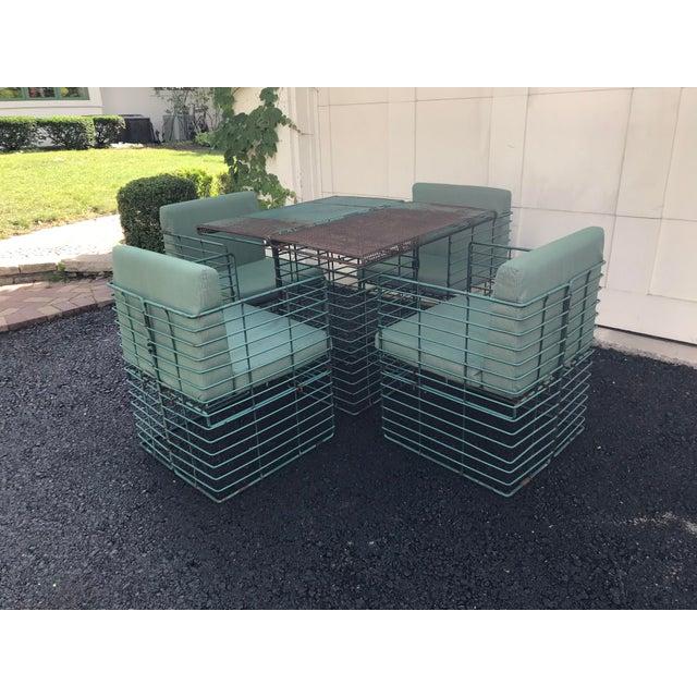 Rare 5-piece outdoor iron dining set in the style of Josef Hoffmann or Mathieu Matégot. Set features unique rectangular...