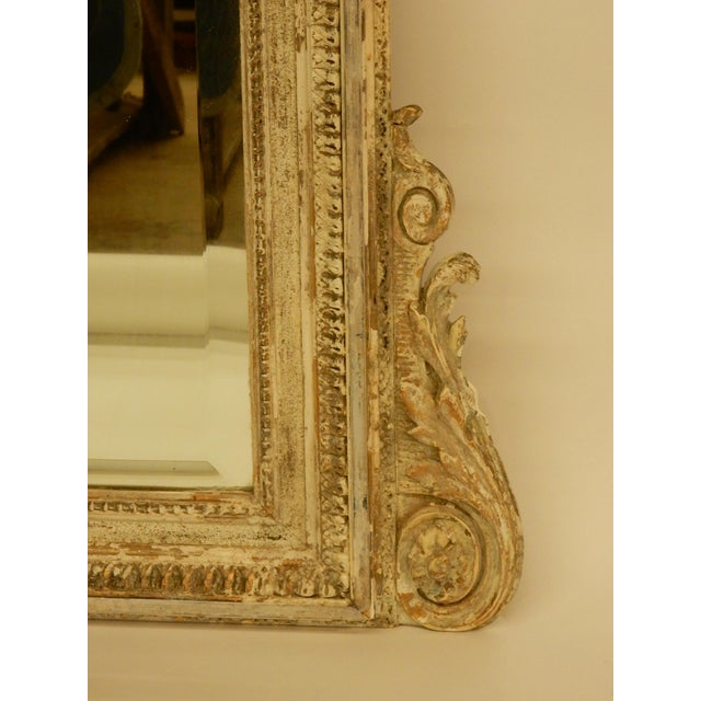 Louis XVI 19th gilt century mirror that has been painted and distressed in the past. has original beveled mirror. Color is...