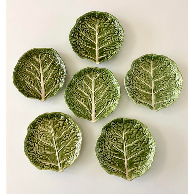 Lovely set of 6 Majolica style green cabbage leaf plates. Vibrant green and white color makes a great set for spring...