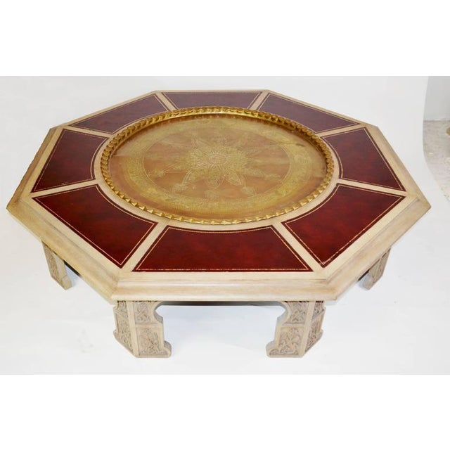 793219df5bc00 A custom coffee table with Moorish arches carved wood base with a leather  inlaid octagonal top