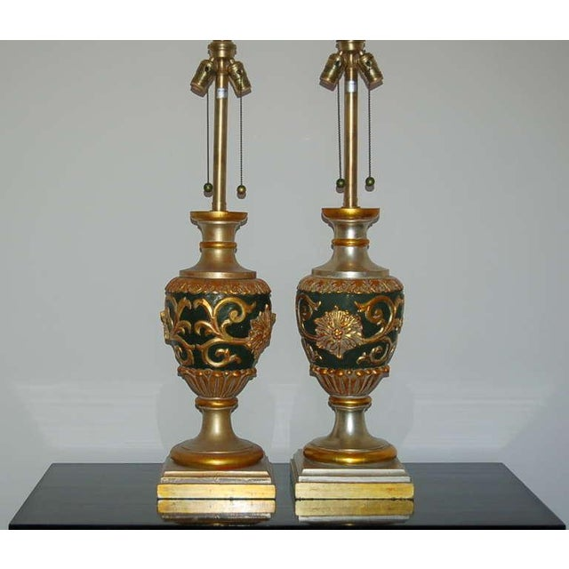 Vintage Italian carved wood table lamps by the Marbro Lamp Company. They are adorned with SILVER AND GOLD LEAFING, against...