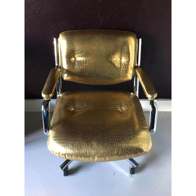 Swiveling office chair in the manner of Castelli circa 1990s. Chrome frame with four casters. Newly upholstered in gold...